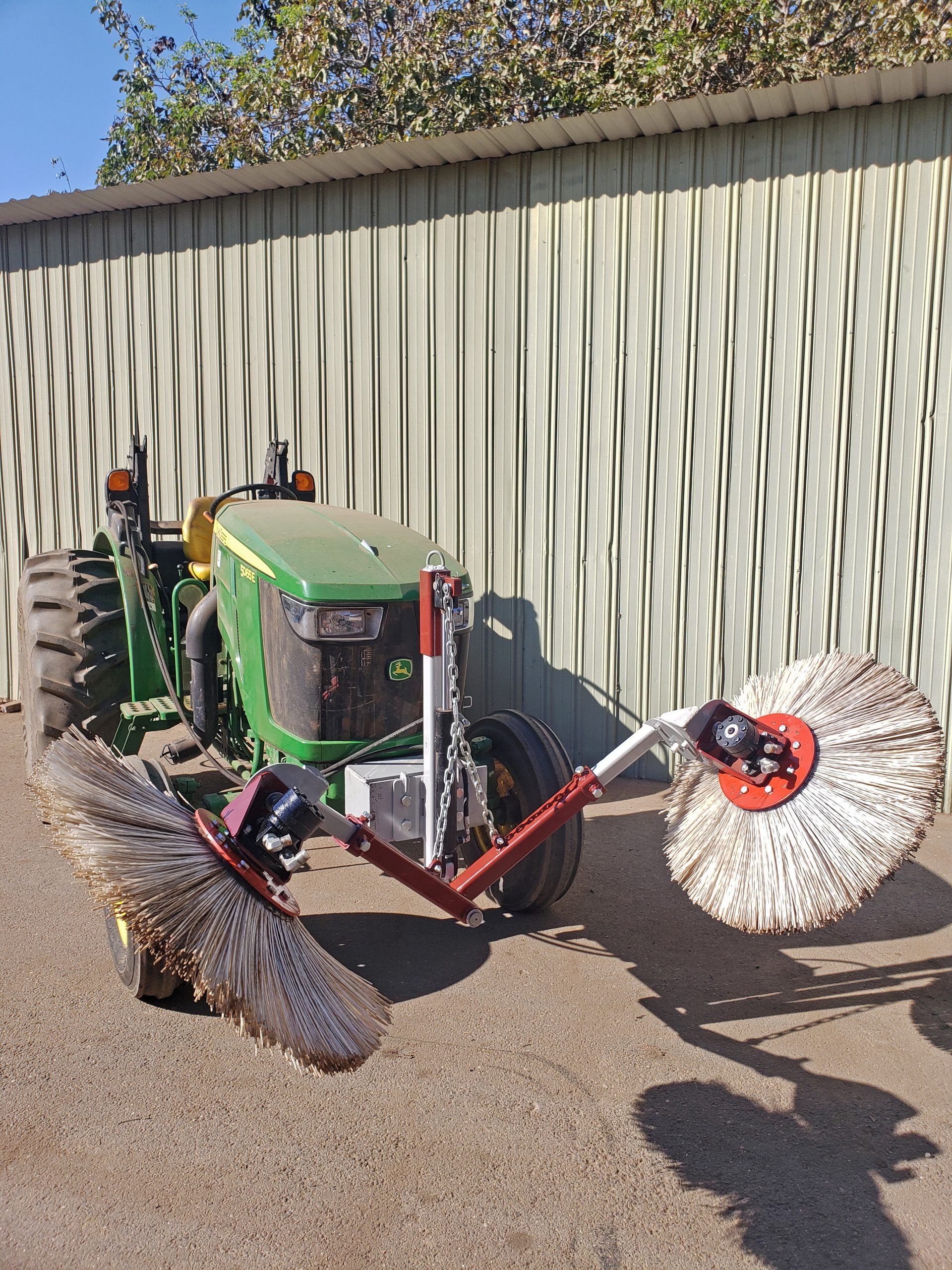 Low pivot frame with bristle brush berm sweepers
